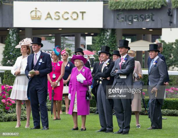 Queen Elizabeth II in the Parade ring with racegoers watching a race on the big screen on day 5 of Royal Ascot at Ascot Racecourse on June 24 2017 in...