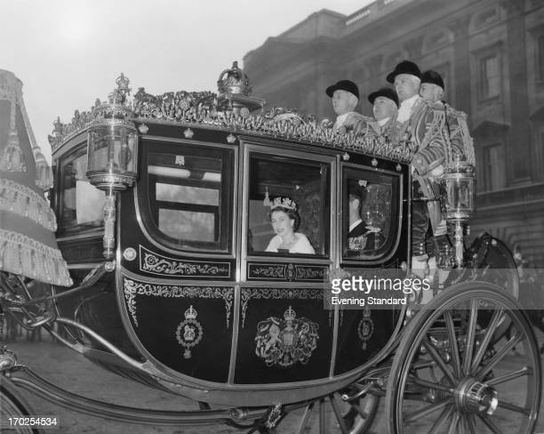 Queen Elizabeth II in the traditional Irish State Coach travelling to Westminster for her first State Opening of Parliament as the crowned sovereign...