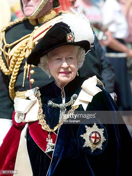 Queen Elizabeth II In The Velvet Robes And Feathered Hat Of The Order Of The Garter Walking In Procession For The Traditional Garter Ceremony At...
