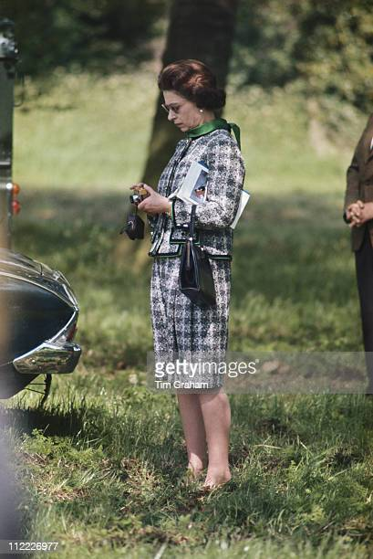 Queen Elizabeth II inspecting her gold Rollei camera at the Royal Windsor Horse Show held at Home Park in Windsor Berkshire England Great Britain May...
