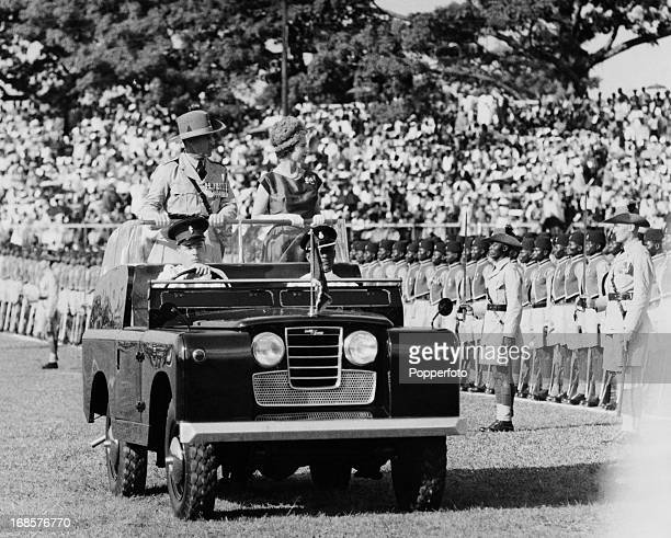 Queen Elizabeth II inspecting troops of the Royal Sierra Leone Regiment from an open Land Rover at Freetown during an official visit to Sierra Leone...