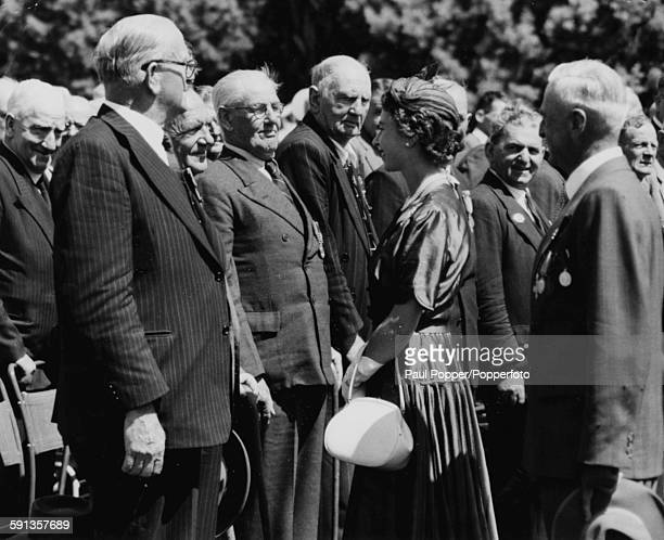 Queen Elizabeth II inspects a guard of ex-servicemen on the lawns of Government House in Canberra, during the Royal Tour of Australia, February 1954.