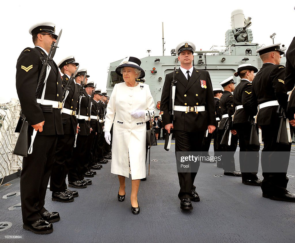 Queen Elizabeth II inspects a Guard of Honour aboard HMCS St John's on June 29, 2010 in Halifax, Canada. The Queen and Duke of Edinburgh are on an eight day tour of Canada starting in Halifax and finishing in Toronto. The trip is to celebrate the centenary of the Canadian Navy and to mark Canada Day. The royal couple will make their way to New York where the Queen will address the UN and visit Ground Zero on July 6.