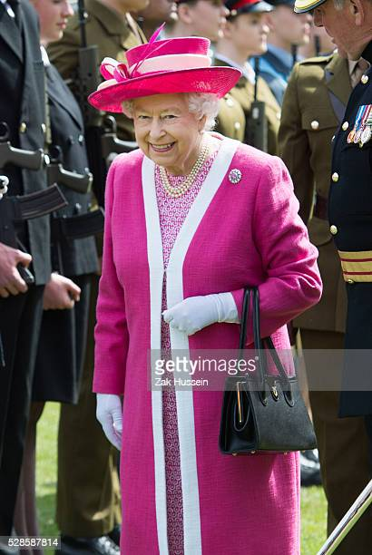 Queen Elizabeth II inspects a Guard of Honour at Berkhamsted School which celebrates its 475th anniversary this year on May 6 2016 in Berkhamsted...