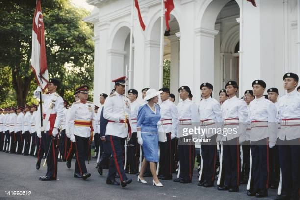 Queen Elizabeth II inspects a Guard of Honour during a visit to Singapore 9th October 1989