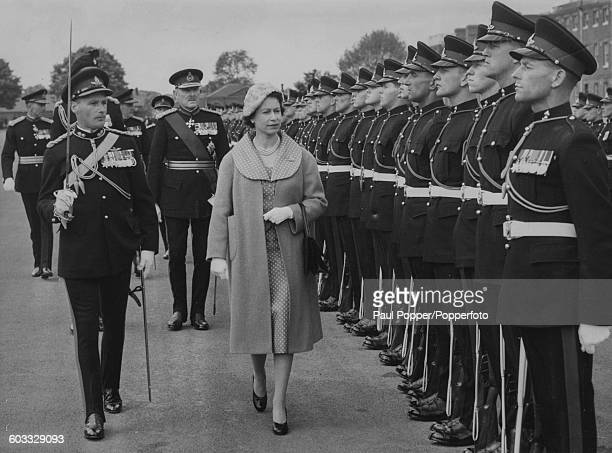 Queen Elizabeth II inspects a Guard of Honour of the 3rd Regiment Royal Horse Artillery during a review of the Royal Artillery at the Royal Artillery...