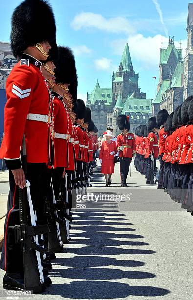 Queen Elizabeth II inspects a Guard of Honour outside the Canadian Parliament after arriving to attend the Canada Day celebrations on July 1 2010 in...