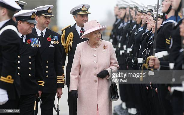 Queen Elizabeth II inspects a navy guard of honour on the quayside at Portsmouth where HMS Ark Royal is moored on November 5 2010 in Portsmouth...