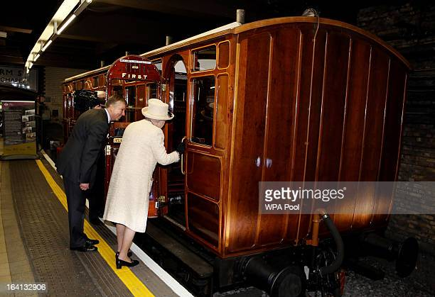 Queen Elizabeth II inspects a vintage train as she makes an official visit to Baker Street Underground Station to mark 150th anniversary of the...