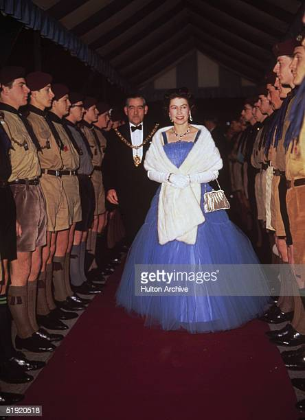 Queen Elizabeth II inspects boy scouts at a performance of the scouting revue 'The Gang Show' 1967