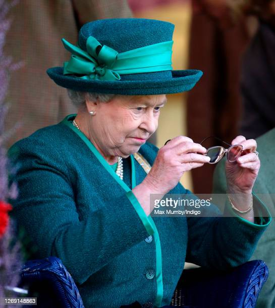 Queen Elizabeth II inspects her spectacles as she attends the 2007 Braemar Highland Gathering at The Princess Royal and Duke of Fife Memorial Park on...