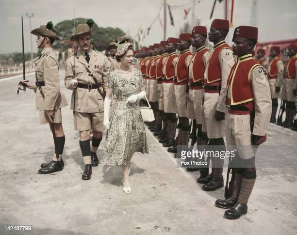 Queen Elizabeth II inspects men of the newlyrenamed Queen's Own Nigeria Regiment Royal West African Frontier Force at Kaduna Airport Nigeria during...