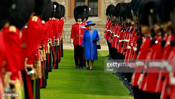 Queen Elizabeth II inspects the 1st Battalion Welsh Guards before presenting them with New Colours at Windsor Castle on April 30, 2015 in London,...