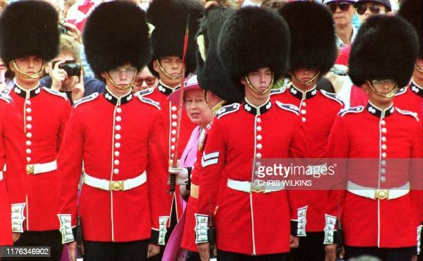 Queen Elizabeth II inspects the Canadian Guard of Honour 01 July 1992 before taking part in Canada Day celebrations on Parliament Hill Ottawa Canada...