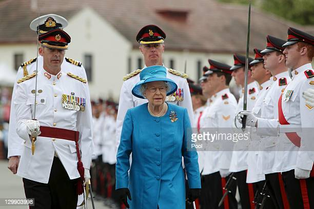 Queen Elizabeth II inspects the guard at the Royal Military College Duntroon where she presented the new colours on October 22, 2011 in Canberra,...