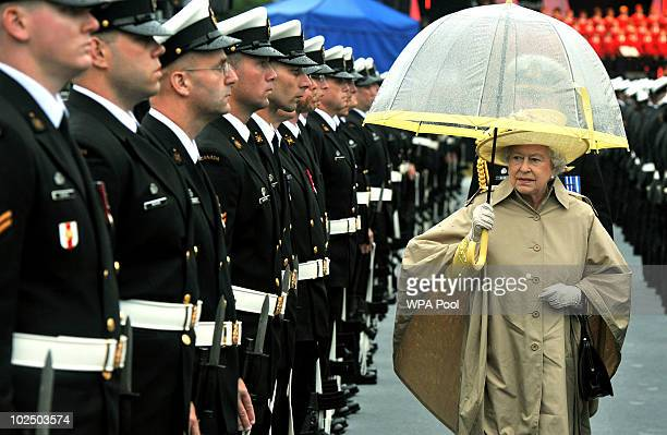 Queen Elizabeth II inspects the Guard of Honour at the Garrison on June 28 2010 in Halifax Canada The Queen and Duke of Edinburgh are on an eight day...