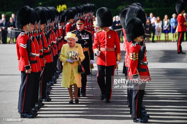 Queen Elizabeth II inspects the guard of honour by F Company, The Scots Guards during the Ceremony of the Keys at the Palace of Holyroodhouse on June...