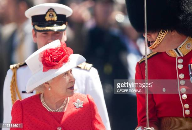 Queen Elizabeth II inspects the Guard of Honour during Canada Day celebrations on Parliament Hill in Ottawa Ontario July 1 2010 The Queen is on a 9...