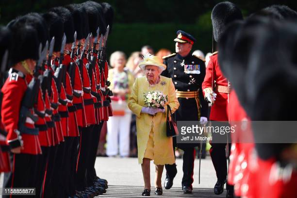 Queen Elizabeth II, inspects the guard of honour, F company, The Scots Guards during the Ceremony of the Keys at the Palace of Holyroodhouse on June...
