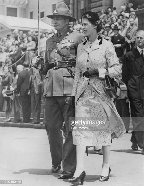 Queen Elizabeth II inspects the Guard of Honour when she attended a state luncheon at Parliament House, Wellington, during the New Zealand leg of her...