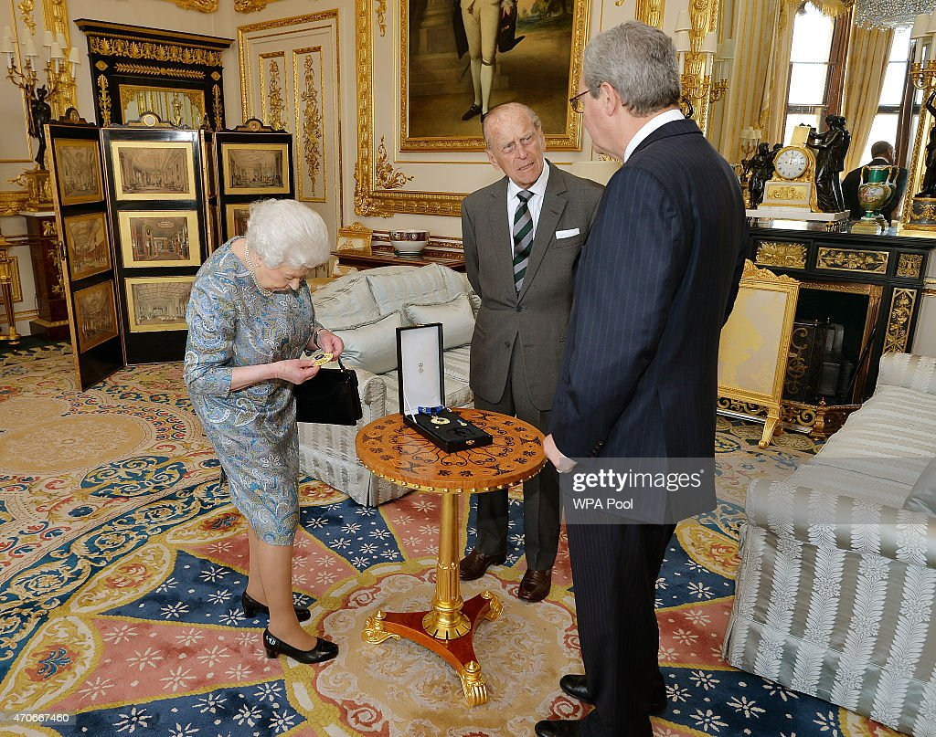 Queen Elizabeth II Presents The Insignia of A Knight of the Order of Australia To Prince Philip, Duke of Edinburgh : News Photo