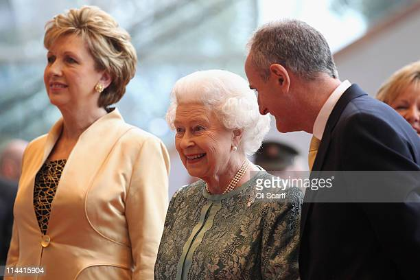 Queen Elizabeth II , Irish President Mary McAleese and her husband Martin McAleese listen to live classical music as they arrive at the Convention...