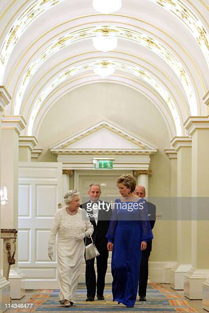 Queen Elizabeth II, Irish President Mary McAleese, Dr. Martin McAleese and Prince Philip, Duke of Edinburgh attend a State Dinner at Dublin Castle,...