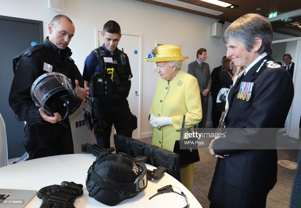 Queen Elizabeth II is accompanied by Commissioner of the Metropolitan Police Cressida Dick as she is shown police equipment during the opening of the the new headquaters of the Metropolitan Police Service on July 13, 2017 in London, England.