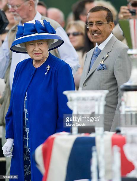 Queen Elizabeth II is accompanied by Mr Khalaf Al Habtoor chairman of Al Habtoor Group of Companies at Guards Polo during the Egham Guards Royal...