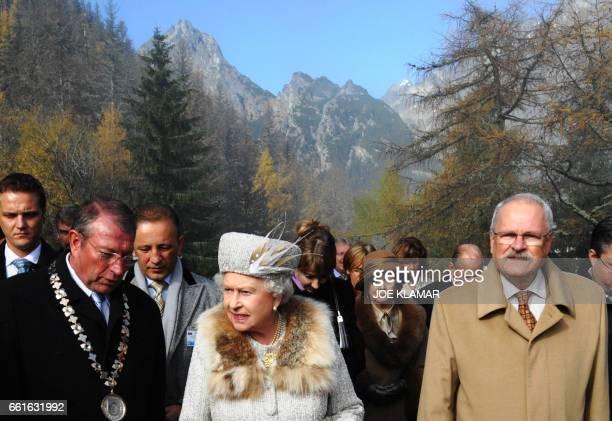 Queen Elizabeth II is accompanied by Slovak President Ivan Gasparovic and Mayor of Vysoke Tatry Jan Mokos during their trip to the Hrebienok ski...