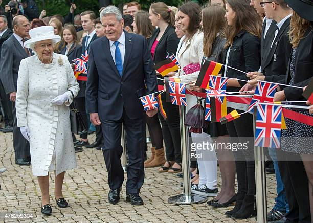 Queen Elizabeth II is ceremonially welcomed with military honours by German President Joachim Gauck at Bellevue Palace the official residence of...