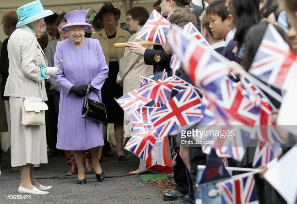 Queen Elizabeth II is cheered by crowds as she arrives at Nine Springs Park on May 2 2012 in Yeovil England The Queen and Duke of Edinburgh are...