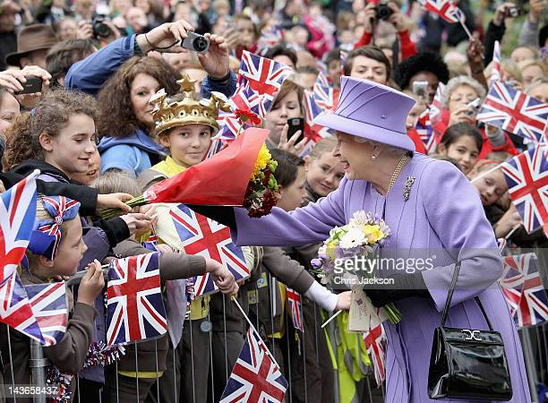 Queen Elizabeth II is cheered by crowds as she arrives at Nine Springs Park on May 2, 2012 in Yeovil, England. The Queen and Duke of Edinburgh are...