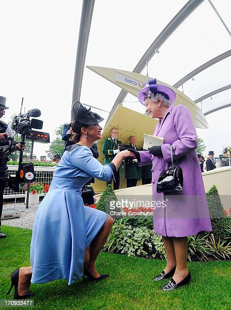 Queen Elizabeth II is congratulated by Princess Haya bint Al Hussein on Ladies' Day during day three of Royal Ascot at Ascot Racecourse on June 20,...