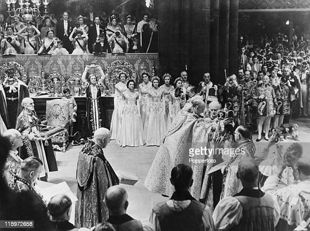 Queen Elizabeth II is crowned by Archbishop of Canterbury Dr Geoffrey Fisher at Westminster Abbey London 2nd June 1953