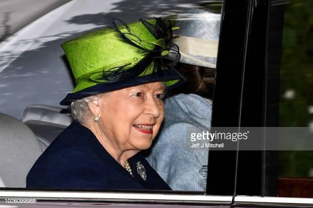 Queen Elizabeth II is driven from Crathie Kirk Church following the service on September 2, 2018 in Crathie, Aberdeenshire, Scotland. Queen Victoria...