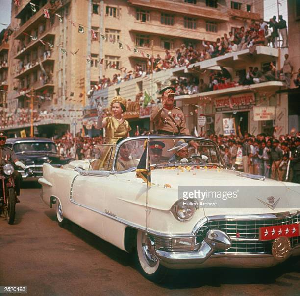 Queen Elizabeth II is driven through the streets of Karachi during the second phase of her tour of Pakistan 1st February 1961