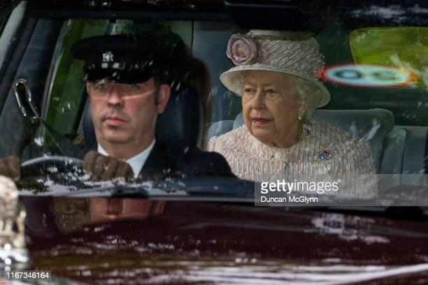 Queen Elizabeth II is driven to Crathie Kirk Church before the service on August 11, 2019 in Crathie, Aberdeenshire. Queen Victoria began worshipping...
