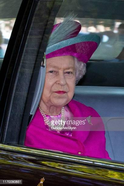 Queen Elizabeth II is driven to Crathie Kirk Church before the service on August 25, 2019 in Crathie, Aberdeenshire. Queen Victoria began worshiping...