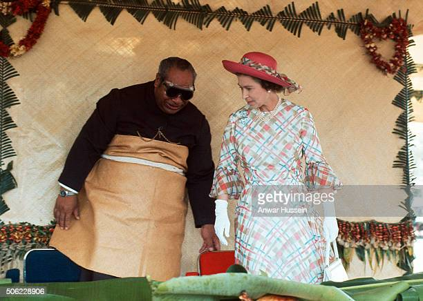 Queen Elizabeth II is entertained by King Taufa'ahau Tupou IV of Tonga at a traditional Tongan feast on February 01, 1977 in Tonga.