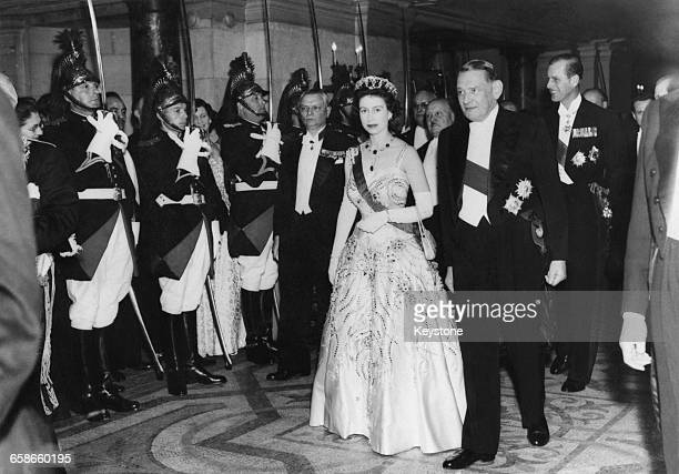 Queen Elizabeth II is escorted by French President René Coty at a gala performance at the Paris Opera during a State Visit to France 8th April 1957...