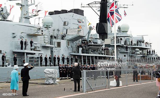 Queen Elizabeth II is given a Royal salute as she views HMS Lancaster during a visit to Portsmouth Naval Base on May 20 2014 in Portsmouth England