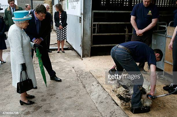 Queen Elizabeth II is given a sheep shearing demonstration at Myerscough College on May 29 2015 in Lancaster England