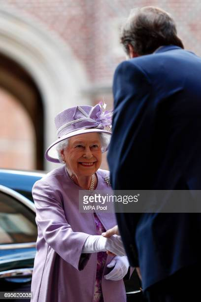 Queen Elizabeth II is greeted as she arrives to attend Evensong in celebration of the centenary of the Order of the Companions of Honour at Hampton...