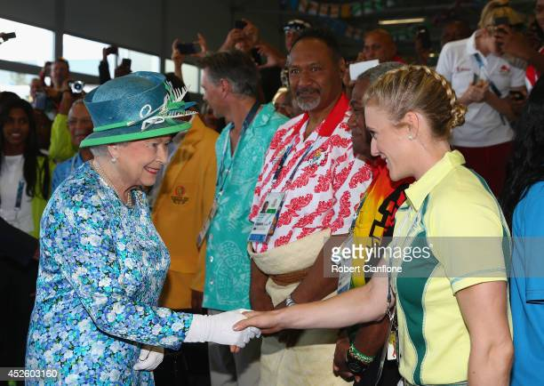 Queen Elizabeth II is greeted by Australian athlete Sally Pearson during a visit to the Athletes Village during the Commonwealth games on July 24...