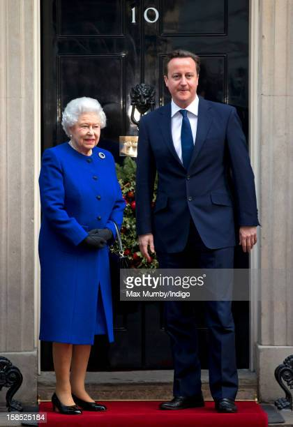 Queen Elizabeth II is greeted by British Prime Minister David Cameron on the doorstep of Number 10 Downing Street as she arrives to attend the...
