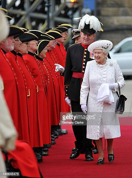 Queen Elizabeth II is greeted by Chelsea pensioners as she arrives at Chelsea Pier on June 3, 2012 in London, England. For only the second time in...