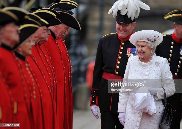 Queen Elizabeth II is greeted by Chelsea pensioners at Chelsea Pier on June 3, 2012 in London, England. For only the second time in its history the...