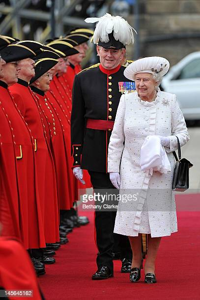 Queen Elizabeth II is greeted by Chelsea pensioners at Chelsea Pier on June 3 2012 in London England For only the second time in its history the UK...