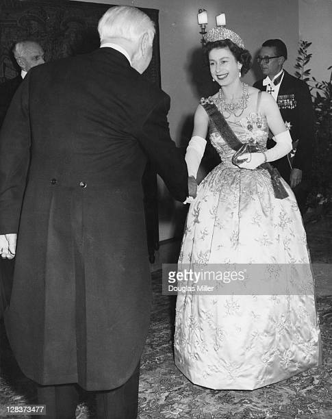 Queen Elizabeth II is greeted by Dr. Theodor Heuss , the President of the Federal Republic of Germany, during her visit to the German Embassy in...